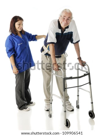 A young teen volunteer keeping an elderly man secure as he ambulates with his walker.  On a white background. - stock photo