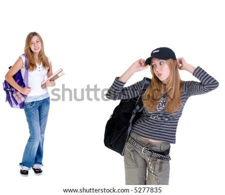 A young teenage girl looking back over her shoulder at her twin???( family, friends, growing up, youth) - stock photo