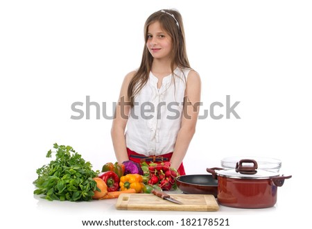 A young teenage girl preparing food isolated on white - stock photo