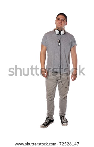 A young teenage man isolated over white wearing black frame nerd glasses and military style dog tags. - stock photo