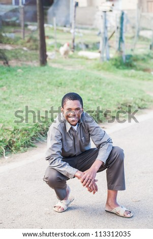 A young teenager are posing for the camera in the street. - stock photo