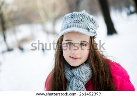 A young teenager dressed for winter in the snow in central park New York - stock photo