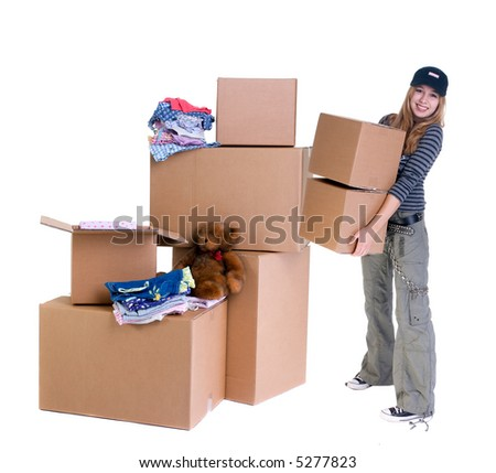 A young teenager packs up her room, time for another change and a new home. - stock photo
