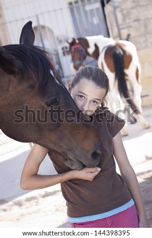 A young teenager with her horse