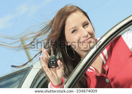 A young tene car driver with car keys on his hand. - stock photo