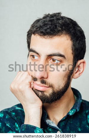 A young tired man close-up in a suit on a gray background, fall asleep. The guy wants to sleep. Gesture. Photos - stock photo