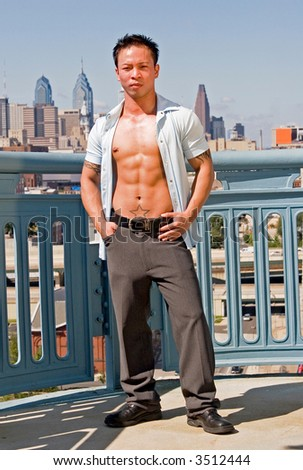 A young well built man in front of the Philadelphia skyline - stock photo