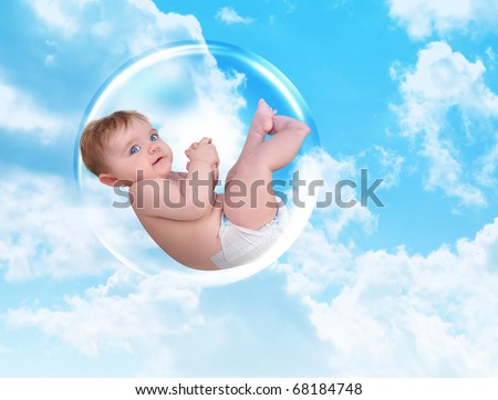 A young white baby is floating in a bubble in the sky with clouds. Symbolizes protection and security. - stock photo