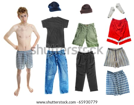 A young white Caucasian adult wearing underwear isolated on white with a bunch of clothes on the right. Mix and match! You can place the clothing on his body. - stock photo