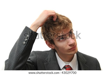 A young white male Caucasian adult in business suit scratching head like a monkey isolated on white
