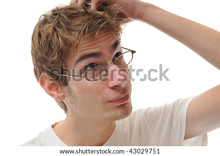A young white male Caucasian adult scratching head isolated on white - stock photo