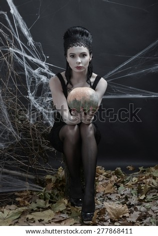 A young witch casts a spell - stock photo