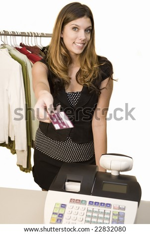 A young woman at a register with credit card - stock photo