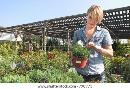 a young woman at the florist's. - stock photo