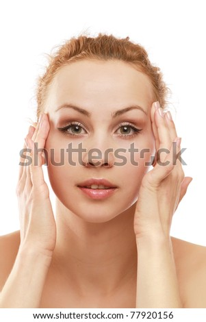 A young woman checking wrinkles on face, closeup - stock photo