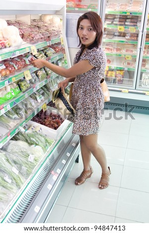 a young woman chooses foods in the store