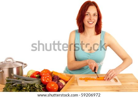 A young woman cuts a carrot