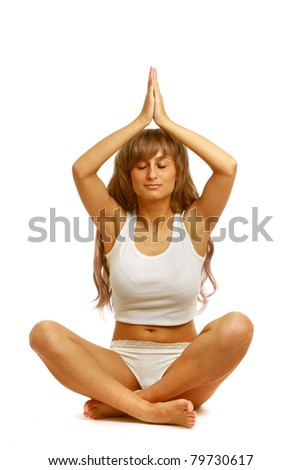 A young woman doing yoga, isolated on white