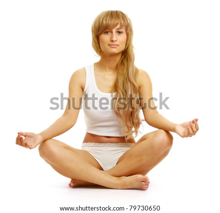 A young woman doing yoga, isolated on white - stock photo