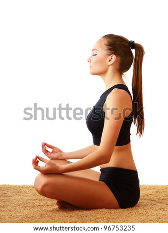 A young woman doing yoga, isolated on white background - stock photo