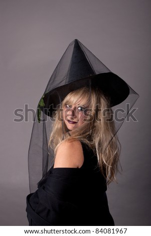a young woman dressed as a witch, makeup for Halloween, halloween party, halloween costume, halloween witch, woman Halloween, scary halloween, spooky halloween image, woman witch
