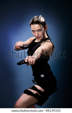 A young woman dressed like the tomb raider - stock photo