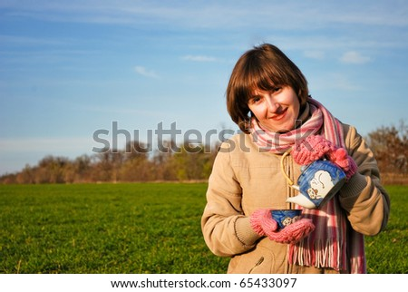 A young woman drinking tea outdoors - stock photo