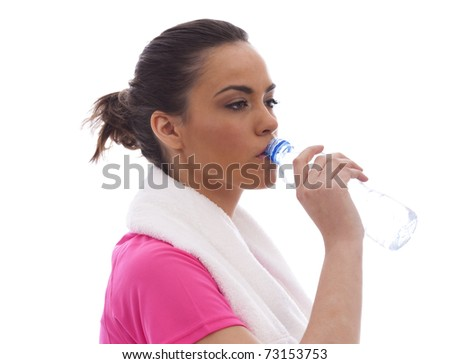 A young woman drinking water after a workout