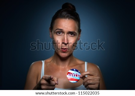 A young woman encouraging you to vote - stock photo