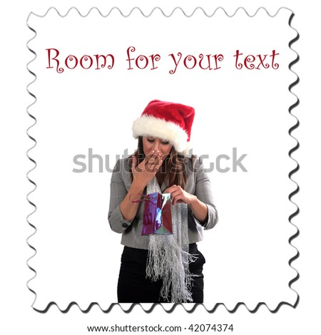 a young woman enjoys a christmas present, isolated on white, with room for your text - stock photo