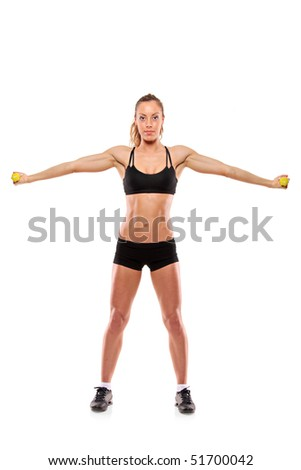 A young woman exercising isolated on white background - stock photo
