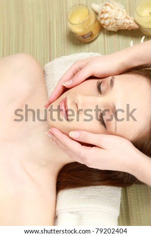 A young woman getting spa treatment, closeup