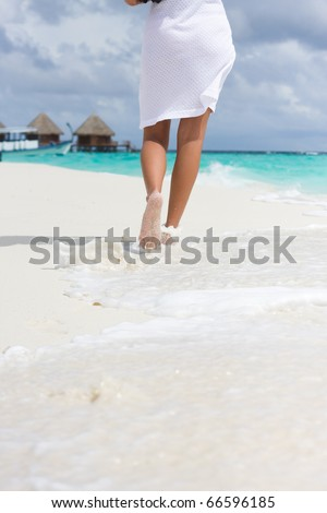 A young woman goes on a coastline