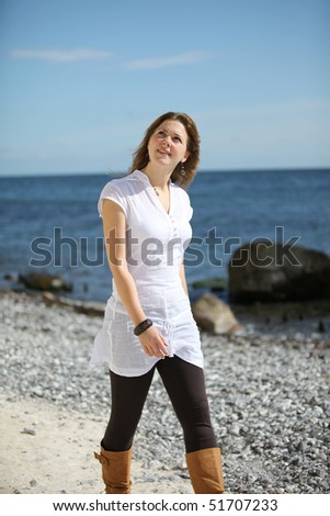 A young woman going for a walk at the beach of R���¼gen - stock photo