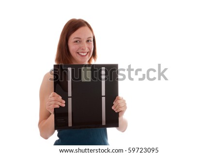 A young woman has a pair of scales in his hand - stock photo