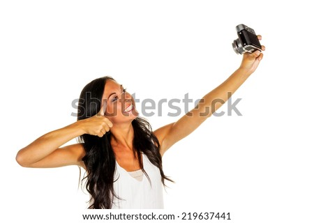 a young woman has fun while they themselves photographed with an old camera. selfie - stock photo