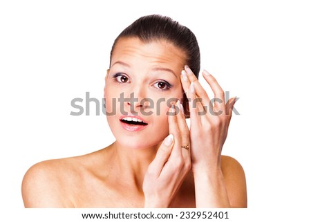 A young woman has problems with the skin. Isolated on white background - stock photo