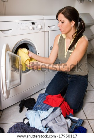 a young woman has wash-day - stock photo
