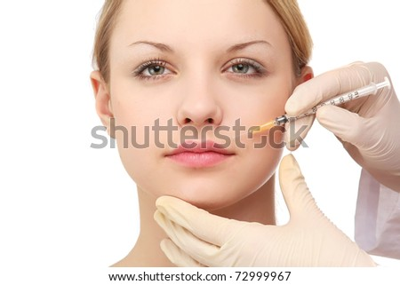 a young woman having an injection - stock photo
