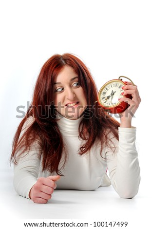 a young Woman hold a clock - stock photo