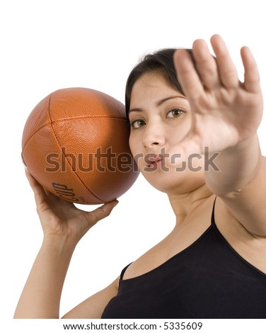 A young woman holding a football over a white background