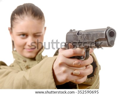 a young woman holding a gun isolated on white background