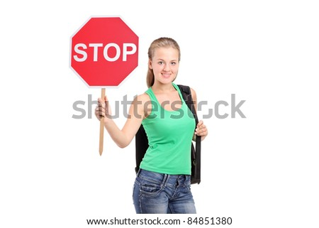 A young woman holding a traffic sign stop isolated on white background