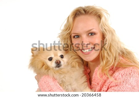 A young woman holding her pomeranian. - stock photo