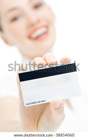 a young woman holding new credit card - stock photo