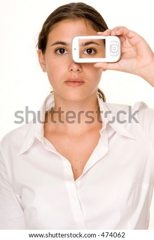 A young woman holds a smartphone to her face and the picture on the phone matches her face - stock photo