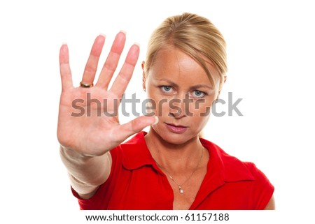 A young woman holds her hands to her face. - stock photo