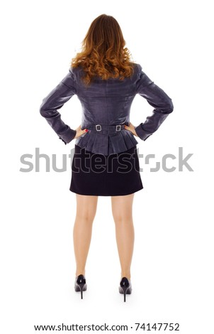 A young woman in a business suit on white background - rear view - stock photo