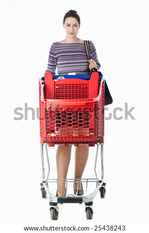 A young woman in a domestic role pushing an empty shopping cart. - stock photo