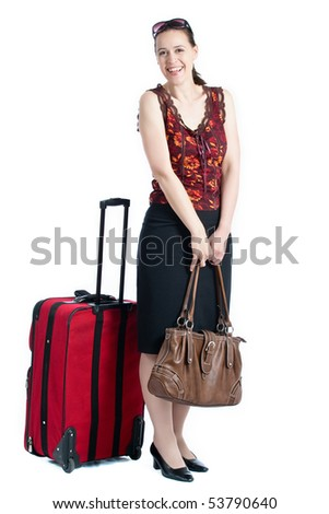 A young woman in a travel scenario with luggage and smiling on white. - stock photo